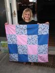 Ellie with her first quilt.