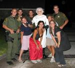 Karem, Hallie, Lisa and I with four officers and the Monster-Thief.