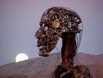 A steel figure watches the moon set at dawn. *Photo by Cherie Sogsti
