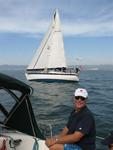 Skipper Charlie with Charissa, a Peterson Liberty 458 in the distance.