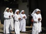 Little girls dressed like nuns?  Aren't they a bit young to make that choice?