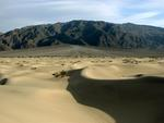 "A dune with an ""alluvial fan"" (that's just a fancy way of saying ""gathering of debris."")"