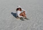 Cherie sitting in the middle of Badwater, Death Valley, the lowest point in the Western Hemisphere.