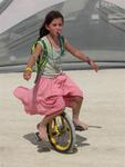 This little girl can hydrate and ride a unicycle simultaneously.