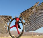 "Cherie during a morning soar in the Black Rock Desert on ""Spread Eagle"", by artist Bryan Tedrick."