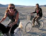 Jean and Greg race across the playa. *Photo by Brian Delaney.