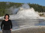 Cherie by a geyser about to erupt in Yellowstone National Park, Wyoming.