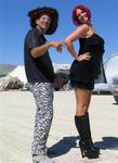 Wearing our fabulous desert outfits at Burning Man.
