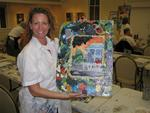Cherie and her painting of a local Key West residence.