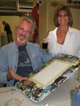 Diane and Theo, owners of Key West's Coffee Plantation, with blank canvases.