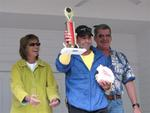 Lloyd Majer won top honors in the men's division.  Lloyd played multiple songs with his conch.