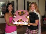 Tonya and Cherie hold the pink ribbon cupcakes from Val and Jeff.