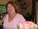 Linda arrives with more pink ribbon cupcakes.
