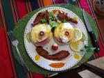 Cherie can't help but play with her food - even if its Charlie's amazing Eggs Benedict breakfast